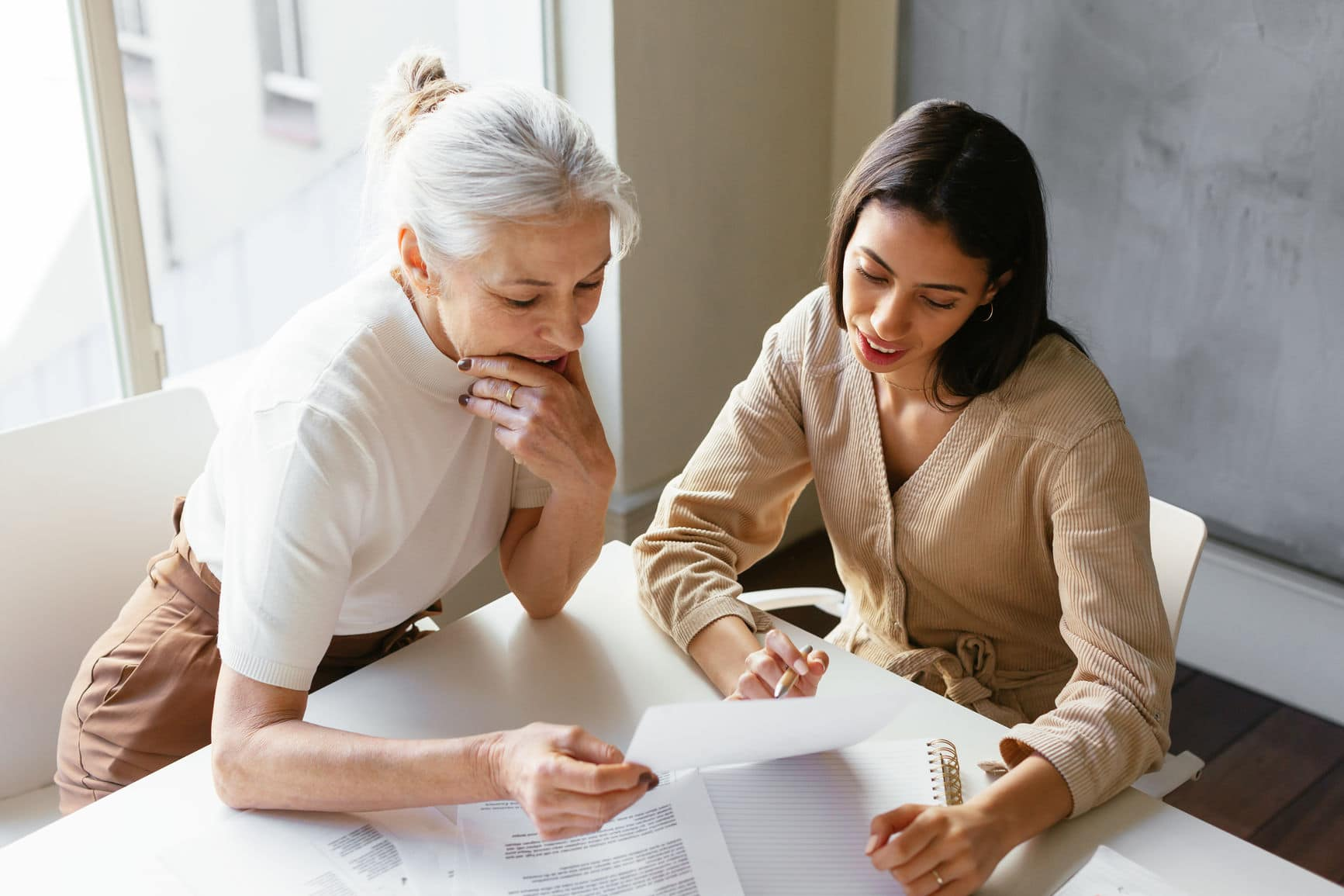 older and younger employee of aging and diverse workforce